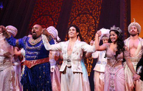 NEW YORK, NY - MARCH 20: James Monroe Iglehart, Adam Jacobs, Courtney Reed during the Broadway Opening Night Performance Curtain Call for Disney's 'Aladdin' at the New Amsterdam Theatre on March 20, 2014 in New York City. (Photo by Walter McBride/WireImage)